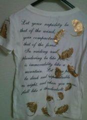 used 美品 「GLAD NEWS」 goldスカル×gold羽print 半袖Tシャツ